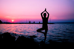 Silhouette woman practicing yoga Royalty Free Stock Photo