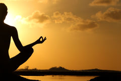 Silhouette of woman practicing yoga Royalty Free Stock Photos