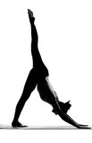Silhouette of woman practising yoga exercises Stock Images