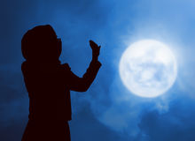 Silhouette woman praying. Image of silhouette woman praying with full moon background Stock Photo