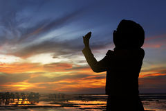 Silhouette of woman praying. Image of silhouette woman praying with sunset background Royalty Free Stock Photos