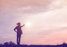 Silhouette of woman praying over beautiful sky Stock Image