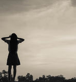 Silhouette of woman praying over beautiful sky background Stock Image