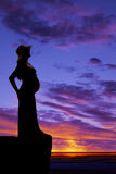 Silhouette woman pregnant in hat side Stock Photography