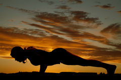 Silhouette woman pushup Stock Images