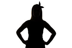 Silhouette of woman with ribbon and hands on hip Royalty Free Stock Images