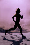 Silhouette woman run in snow Stock Photo