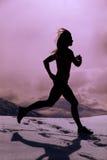 Silhouette woman run in snow Stock Photo