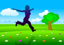 Silhouette of woman running on meadow Stock Images