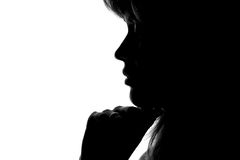Silhouette of a woman's face on a white background Royalty Free Stock Photography
