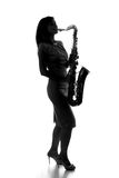 Silhouette of a woman with a saxophone Stock Photography