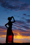 Silhouette woman see through skirt hand hat Stock Images