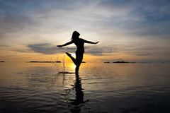 Silhouette of woman  in shallow water Royalty Free Stock Photo