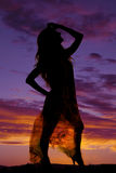 Silhouette of a woman in a sheer dress look up Stock Images