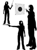Silhouette woman shoots target pistol Stock Photo