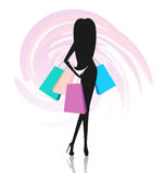 Silhouette of woman with shopping bags Royalty Free Stock Photography