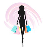 Silhouette of woman with shopping bags Stock Photo