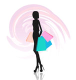 Silhouette of woman with shopping bags Stock Photos