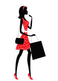 Silhouette of a woman shopping. Stock Photography