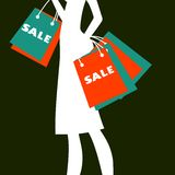Silhouette of a woman shopping Royalty Free Stock Image