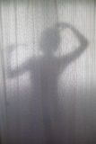 Silhouette of Woman Showering Stock Photos