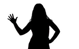 Silhouette of woman showing greeting Stock Photo