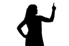 Silhouette of woman showing up, left side Stock Image