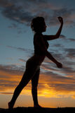 Silhouette woman side arms up and down Stock Images