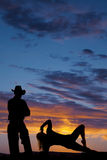 Silhouette of woman side plank hand by head by cowboy Royalty Free Stock Photos