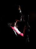 Silhouette of woman singing. Silhouette of woman singing into vintage microphone royalty free stock images