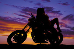 Silhouette woman sit backward on motorcycle Royalty Free Stock Images