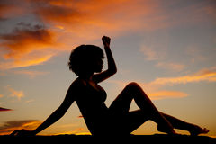 Silhouette woman sit hand up legs out Royalty Free Stock Image