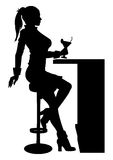 Silhouette woman sitting at the bar with cocktail  Royalty Free Stock Images