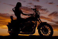 Silhouette of woman sitting on motorcycle Stock Image