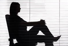 Silhouette of woman sitting in the office (blind) Royalty Free Stock Photography