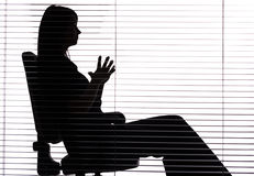 Silhouette of woman sitting in the office (blind). Isolated on white silhouette of woman sitting in the office (blind Royalty Free Stock Images