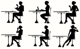 Silhouette of Woman Sitting At The Table. Royalty Free Stock Images