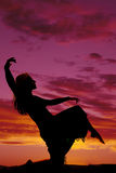 Silhouette of a woman in a skirt kneel leg up Stock Photos