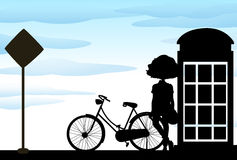 Silhouette of woman standing with bicycle Royalty Free Stock Photos