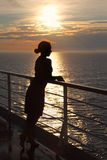 Silhouette of woman standing on deck Stock Image