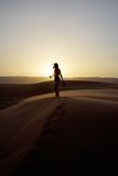 Silhouette of Woman Standing on Dessert during Sunset Royalty Free Stock Image