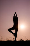 Silhouette woman with standing position yoga. Royalty Free Stock Photos