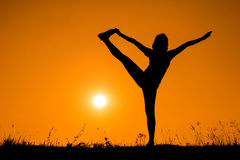Silhouette woman with standing position yoga. Stock Image
