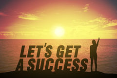 Silhouette woman standing and raising up her finger about fighting concept on let get success text Stock Images