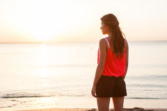Silhouette of Woman standing on a sandy beach Royalty Free Stock Photography