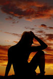 Silhouette of a woman stressed sitting Stock Images