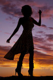 Silhouette woman stripe dress blow look back Stock Image