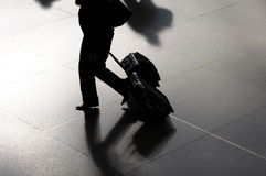 Silhouette of a woman with suitcases Royalty Free Stock Image