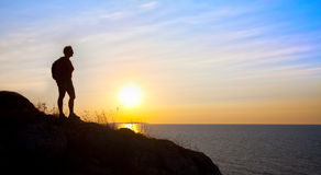 Silhouette woman on sunset Stock Photography