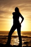 Silhouette of a woman at sunset. By the ocean, South Africa stock photography